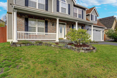 Gray mixed siding home exterior with nice landscaping on a perfect sunny day. 写真素材