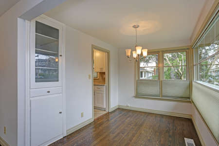 White empty dining area with new hardwood floor.