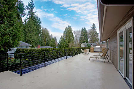 Stunning home exterior features large deck with a custom built in BBQ and beautiful view.