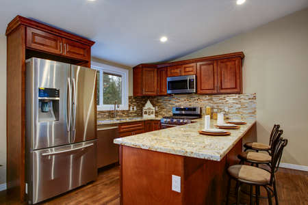 Brown Kitchen Design With Mahogany Cabinets Breakfast Bar Stools Granite Counter Top