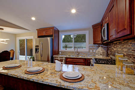 Brown kitchen design with mahogany kitchen cabinets, breakfast..