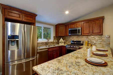 Brown kitchen design with mahogany kitchen cabinets, breakfast..