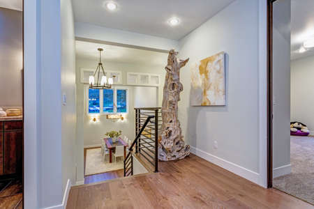 Second Floor Landing With White Walls Maple Hardwood Floor And