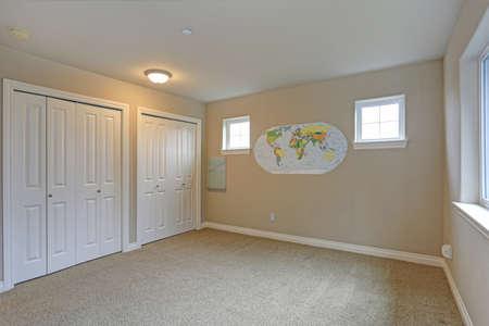 Light beige empty room interior with white closet doors.