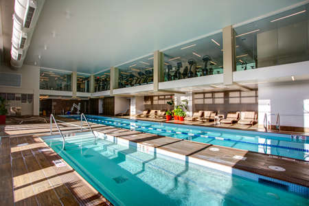 indoor gym pool. Interesting Pool Stock Photo  Upscale Indoor Swimming Pool With Swim Lanes And 2 Level Gym  In Condominium Complex Throughout Gym Pool