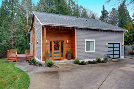 Charming newly renovated home exterior, natural wood siding and grey siding create a beautiful curb appeal.