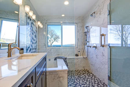 Luxury bathroom design with Marble shower Surround and mosaic accent tiles.  Stock Photo