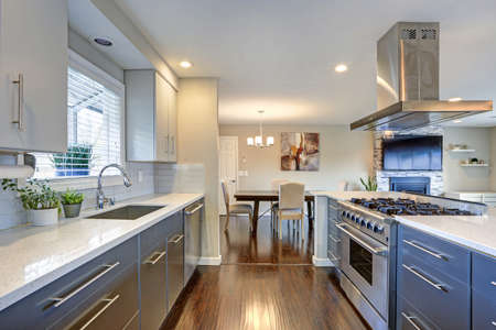 Stylishly updated kitchen with quartz countertops and stainless steel appliances. Stock Photo