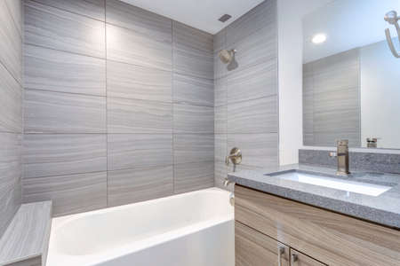 Interior of grey modern bathroom after remodeling. 스톡 콘텐츠