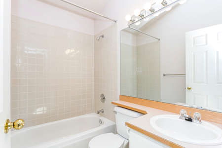 Renovated interior of a white bathroom with tiled wall. Banque d'images
