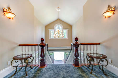 Stunning foyer with elegant staircase and vaulted ceiling.