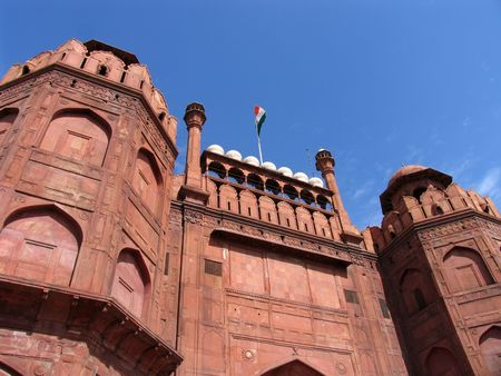 imposing: Indian Flag flying over the imposing entrance to the Red Fort in Delhi, India Stock Photo