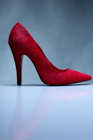 Red high heels isolated on gray background