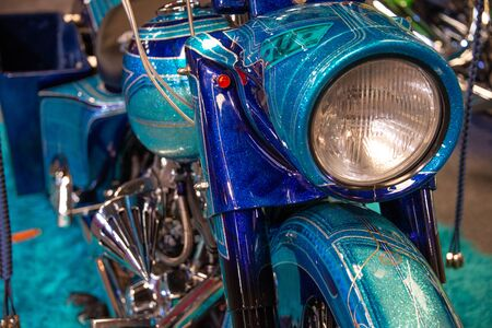 Front view of metallic blue motorcycle with silver flashes and chromed