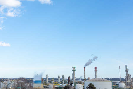 view of petrochemical industry with details of chimneys and blue sky