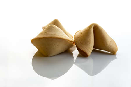 Chinese fortune cookies with golden and brown color and white background Archivio Fotografico