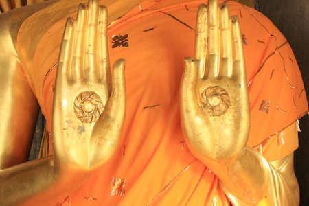 Hands of statue Buddha, Lampang, Thailand photo