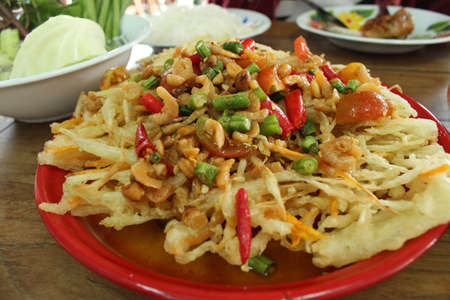 Fried papaya salad  photo