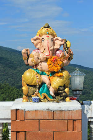 a righteous person: White ganesha statue in sitting action with many decoration  Stock Photo