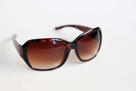 modern stylish sunglasses against white background