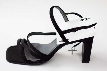 high heeled shoe: ace in high heeled shoe against white background