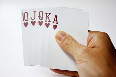 royal flush in hand against white background Stock Photo