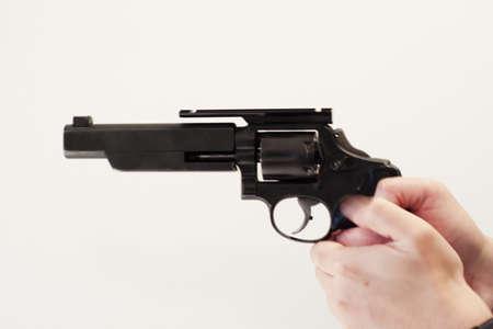 anti war: gun in hand against white background