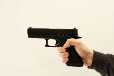 anti war: semi-automatic pistol in hand