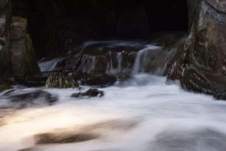 flowing water: flowing water around rocks Stock Photo