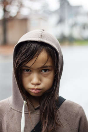 forlorn: young girl on rainy day