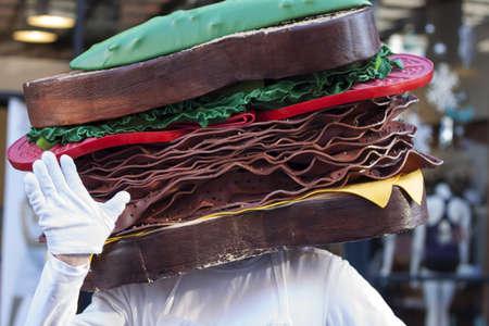 comedic: pastrami sandwich head mascot in yaletown