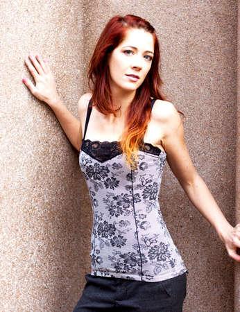pretty redhead against wall