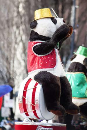 bear sitting on drum set at christmas parade photo