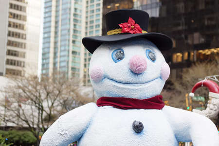happy snowman in downtown vancouver - closeup Stock Photo
