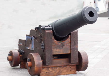 old-fashioned cannon replica on display at waterfront
