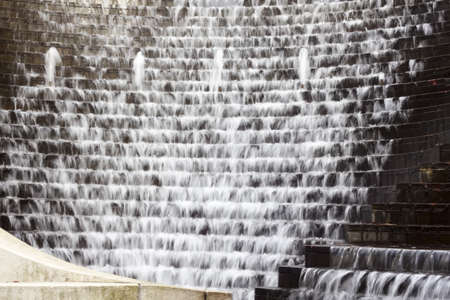 cascading: water cascading down steps - feathery