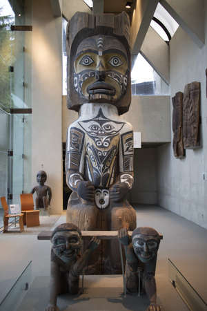 ancestral: wooden totem figure with supporting characters