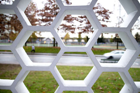lattice window: looking upon street through latticed window