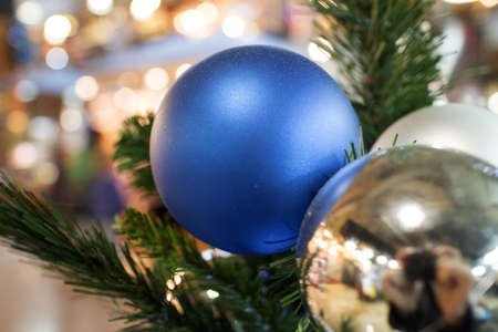 another bright blue ornament on christmas tree Stok Fotoğraf