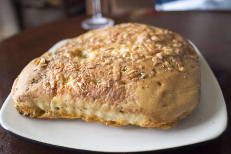 doughy: three cheese foccacia bread on white plate