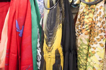 skirts: some long silk skirts on rack