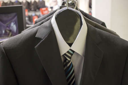 tailored: some suits and shirts on a rack