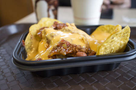 eatery: nacho chips with chili and cheese