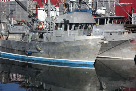gunmetal: some old boats at dock
