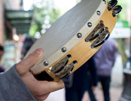 a tambourine shaking on the street