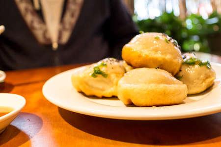 potstickers: tasty fried potstickers in restaurant Stock Photo