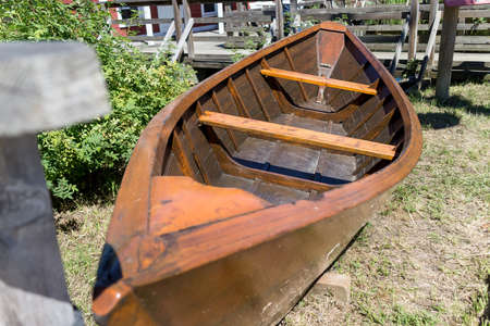 an old rowboat on lawn
