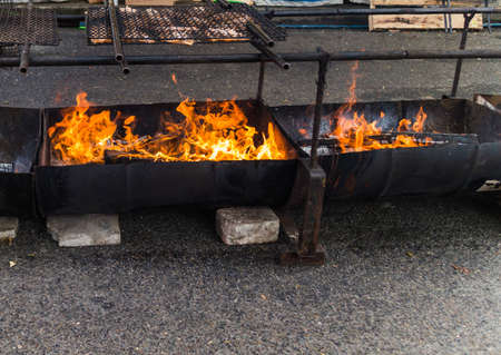 flaming barbecue pit on street