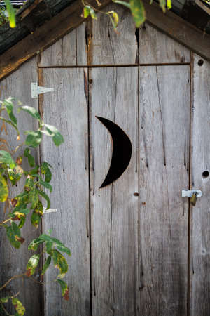 crescent: an outhouse with crescent opening