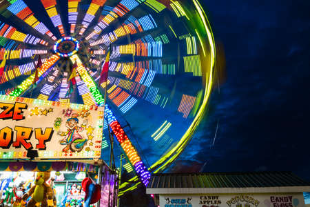 midway: a ferris wheel on fairgrounds-in motion